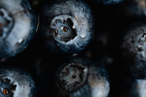 Heap of ripe and sweet blueberries on background