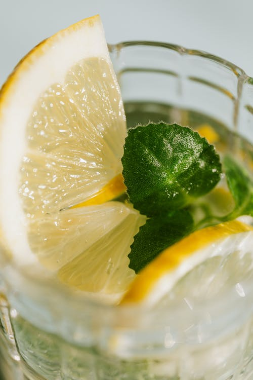 Glass of fresh cocktail with lemon
