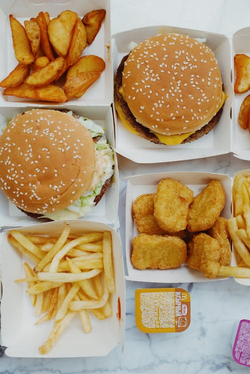 Appetizing fast food on marble table