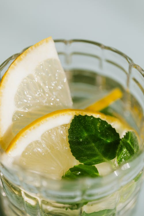 Glass of fresh cocktail with lemon and mint