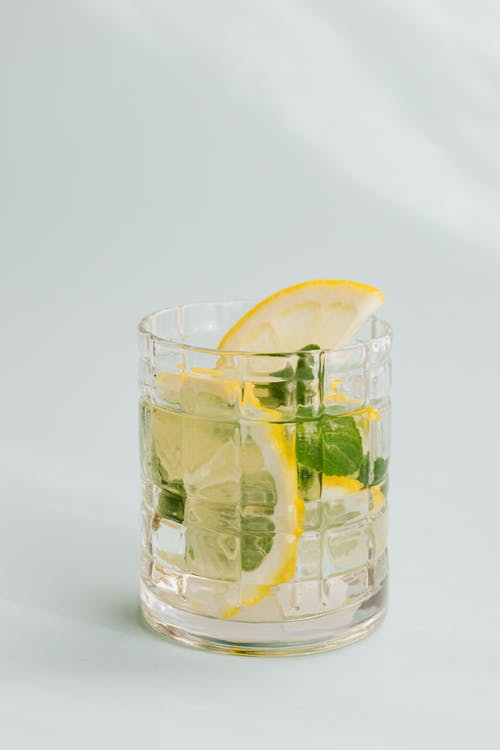 Glass of fresh drink placed on white background