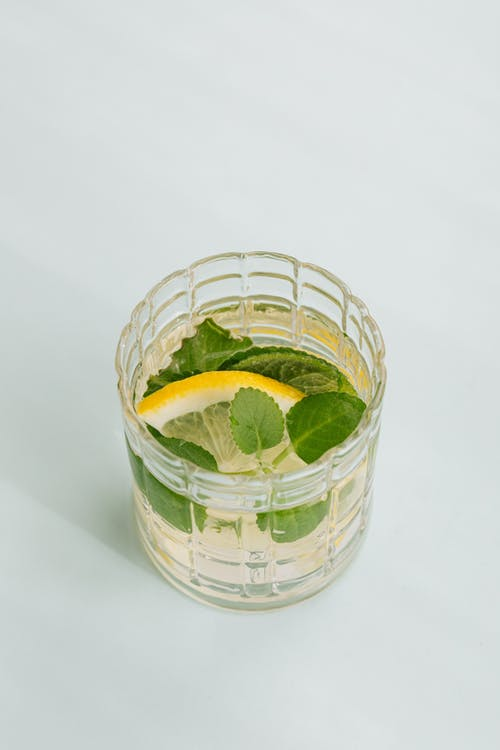 Glass of cocktail on white background