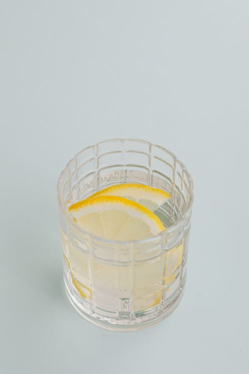 Glass of cold drink with lemon