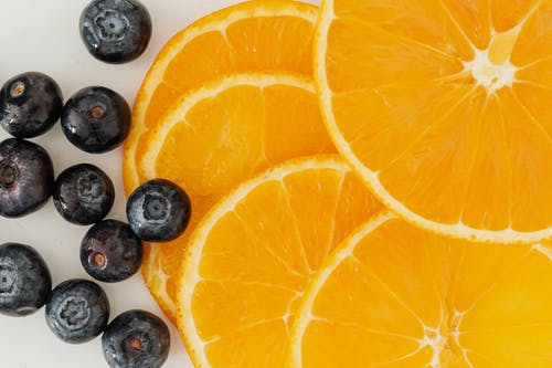 Orange slices and blueberries on table