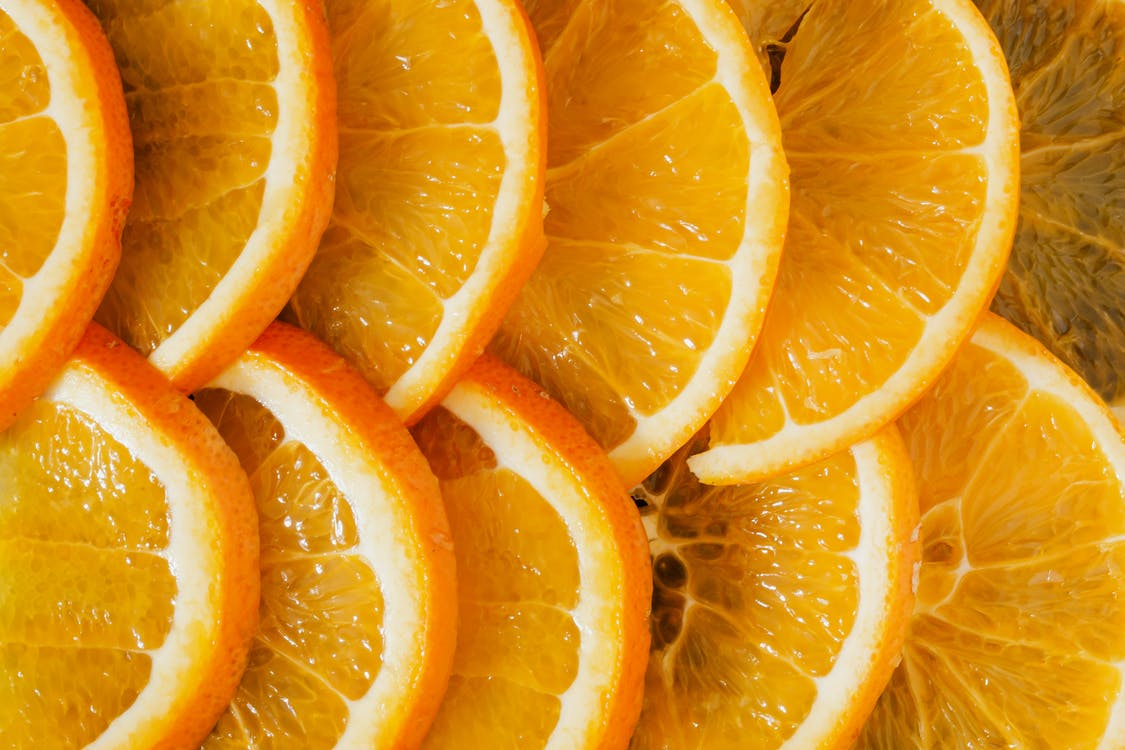 Composition of juicy organic slices of citruses laid out clinging to each other