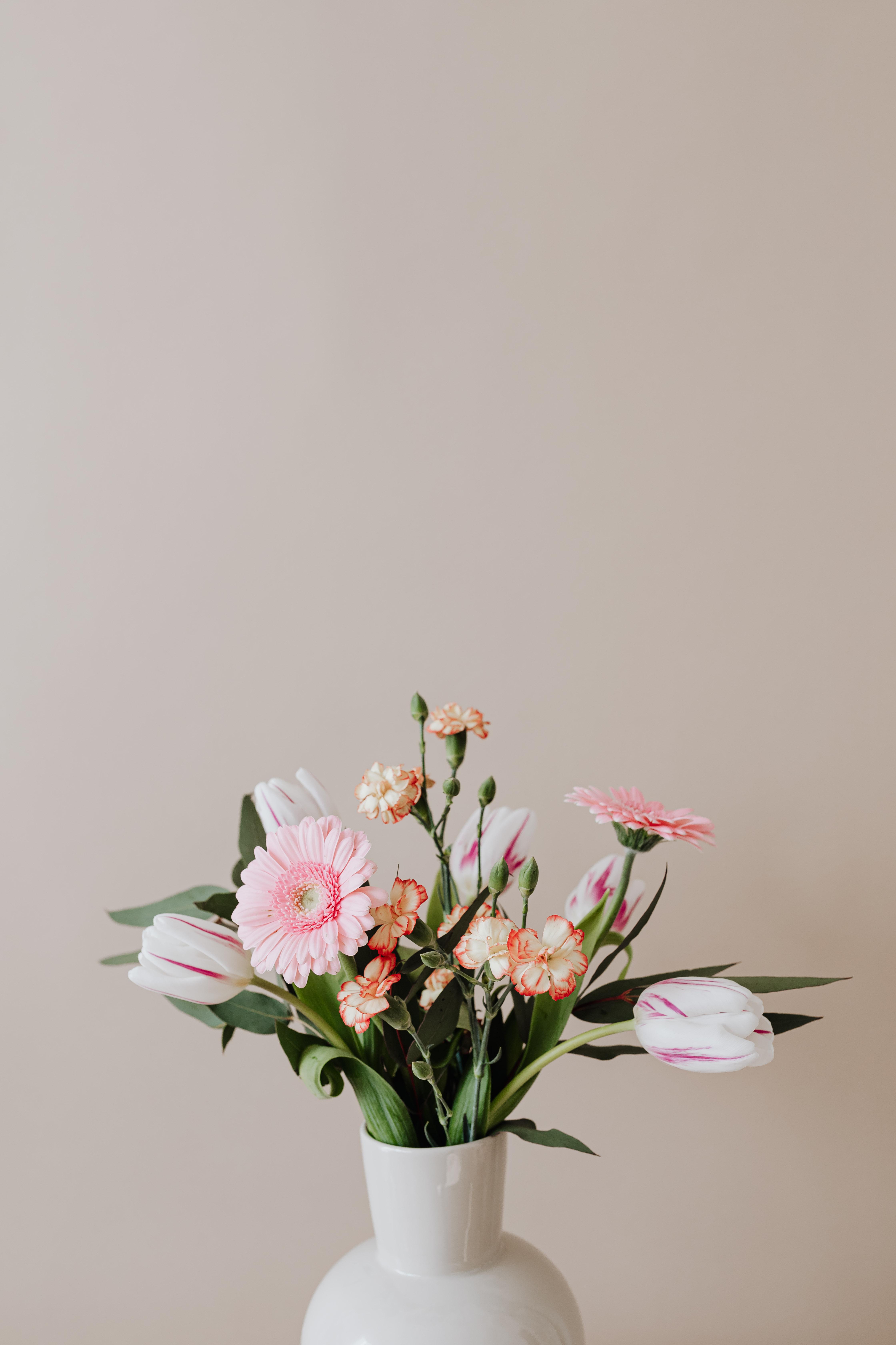 white ceramic vase with fresh flowers