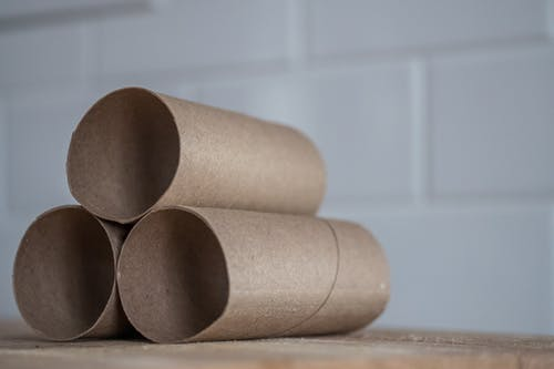 Stack of carton rolls on table