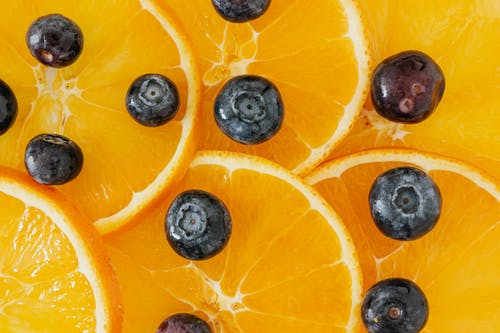 Slices of orange and blueberry