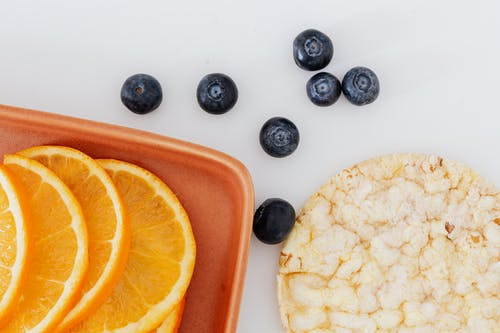 Fresh oranges and blueberries and rice cracker