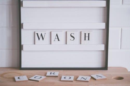 Wash and Corona inscriptions in bathroom