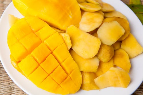 Yellow Sliced Fruit On White Plate