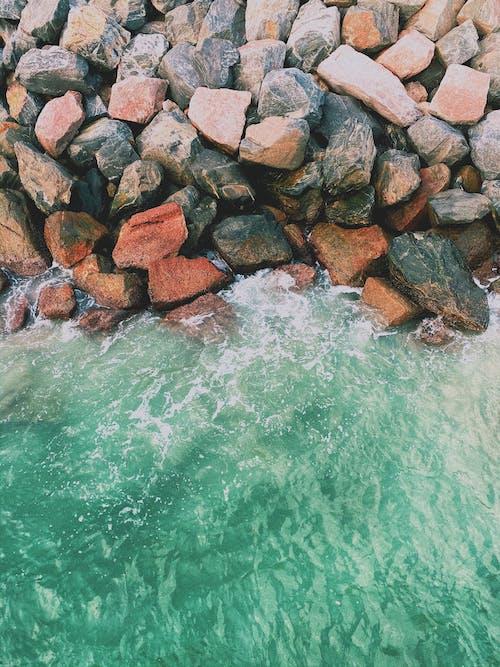 Aerial Shot Of Rocks Beside Body Of Water