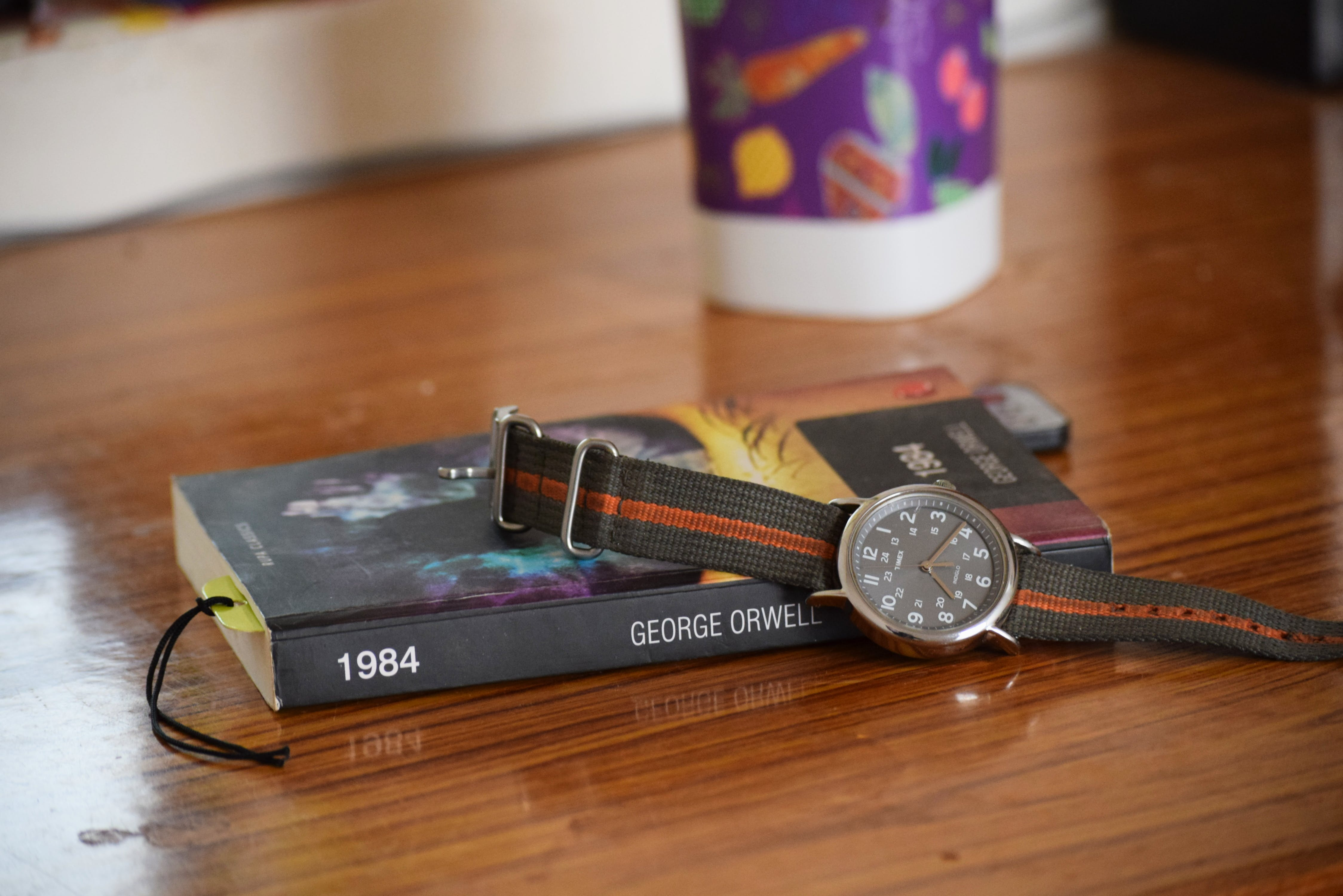 Free stock photo of Analog watch, book, tea cup