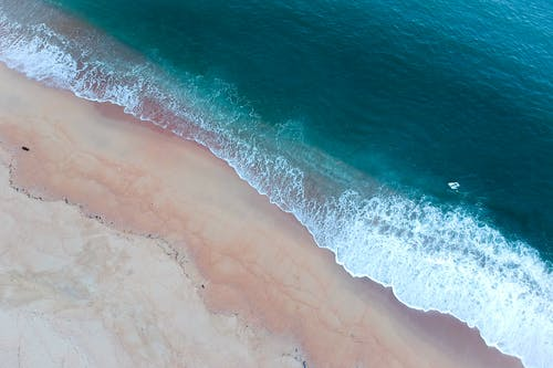 Aerial Shot Of Ocean Waves On Shore