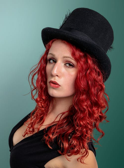 Woman with Red Hair and a Black Top Hat