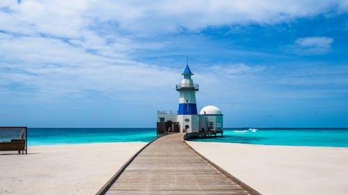 deniz, deniz feneri, deniz kıyısı içeren Ücretsiz stok fotoğraf