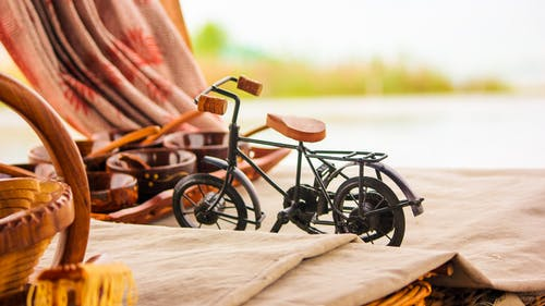 Free stock photo of bicycle, canon, carved wood