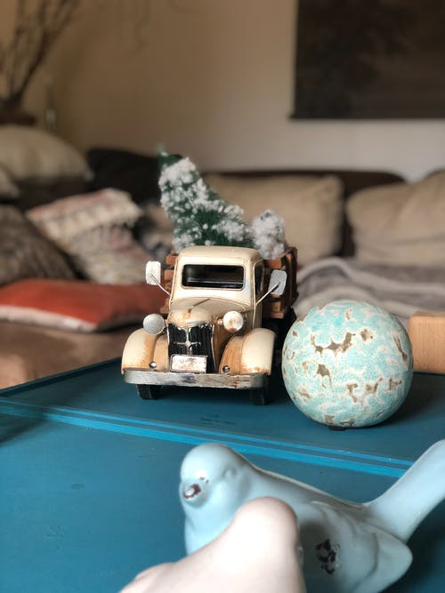 White and Brown Vintage Car Scale Model on Green Table