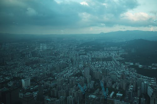 Aerial View of City Buildings Under Cloudy Sky