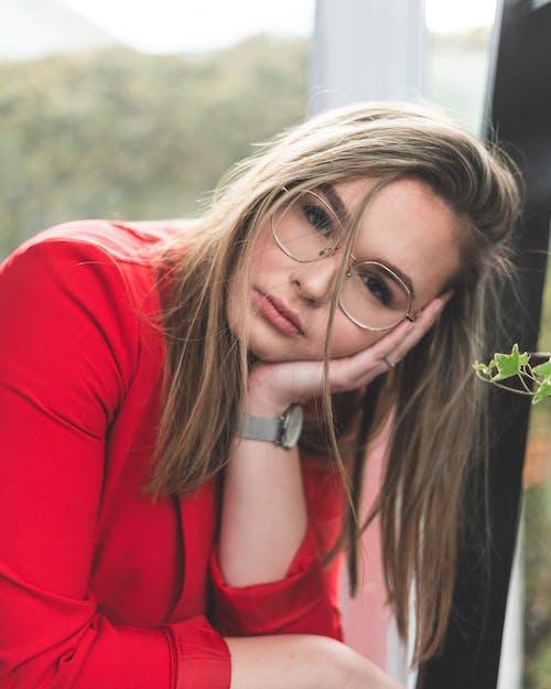 Woman In Red Jacket Wearing Eyeglasses