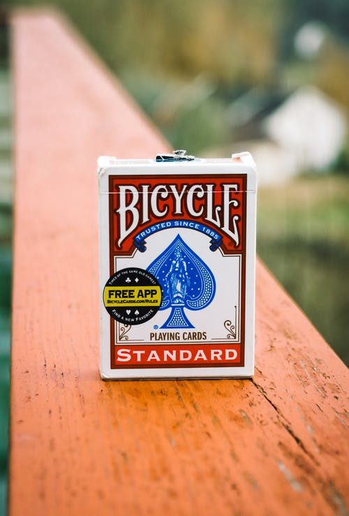 Cardboard box of cards with BICYCLE and STANDARD inscriptions outdoors