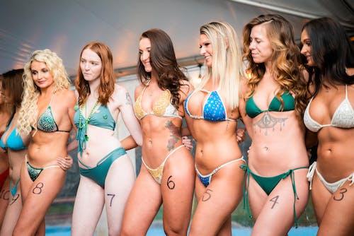 3 Women in Bikini Standing on Beach