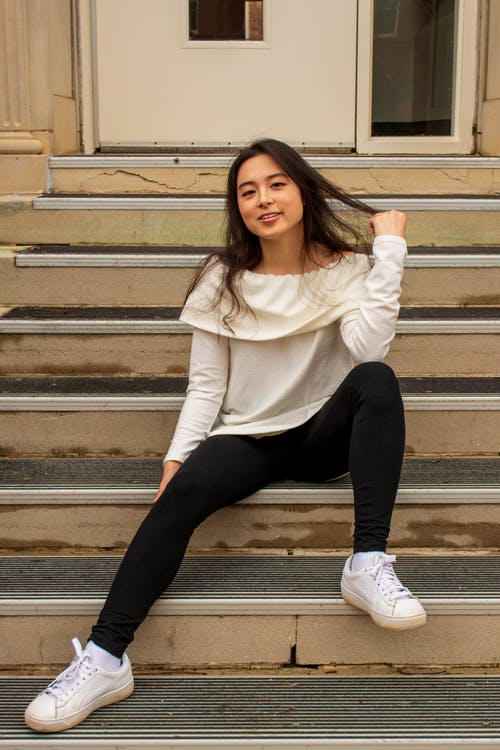 Free stock photo of brown hair, college student, sitting on stairs