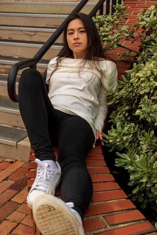 Free stock photo of brick, brown hair, lying down