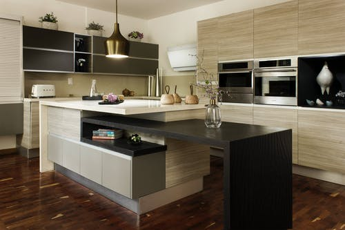 Black Wooden Kitchen Cabinet With Stainless Steel Faucet