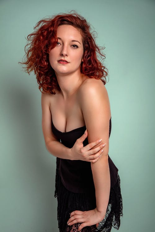 Woman With Red Hair in Black Dress
