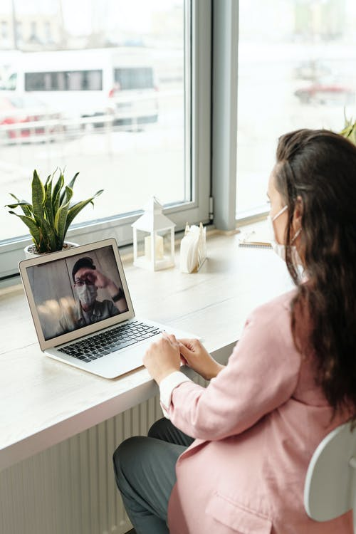 Woman Using Her Laptop On Video Call