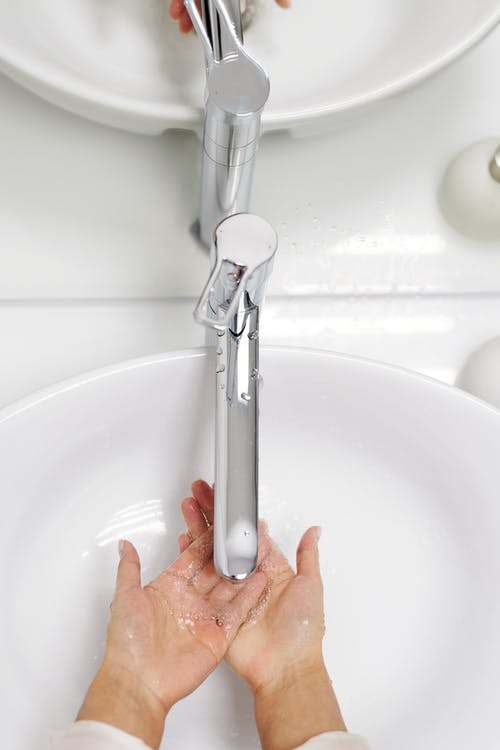 Woman Washing Her Hands With Soap