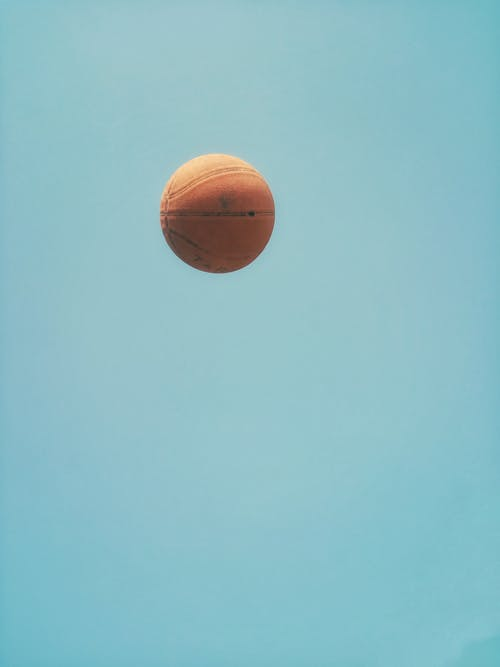 Brown Basketball on Blue Sky