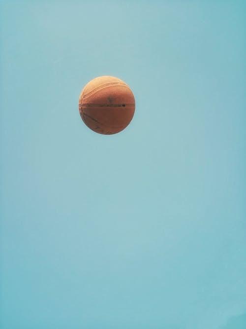 Brown Basketball on Blue Sky