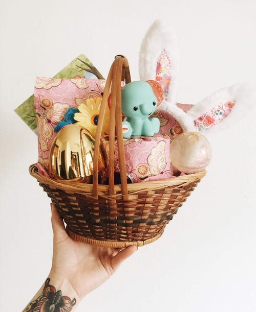 White and Pink Rabbit Figurine on Brown Woven Basket