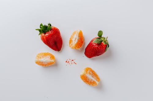Strawberries And Orange Fruit On Blue Background