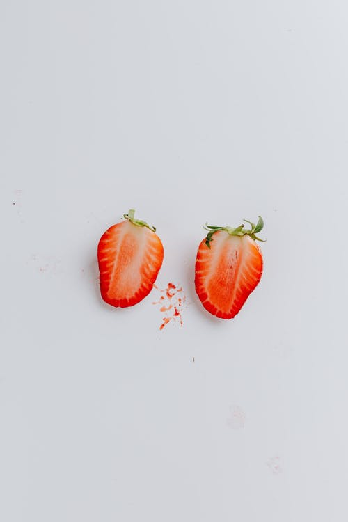 Sliced Strawberry On Blue Background