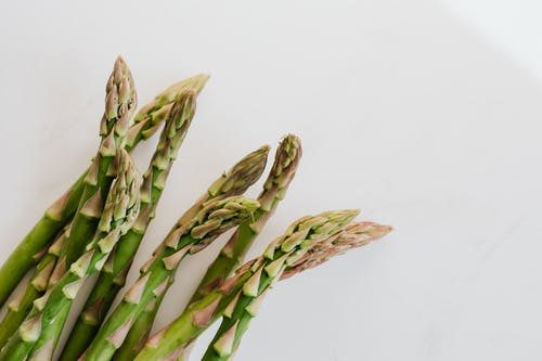 Fresh ripe asparagus pods in bunch