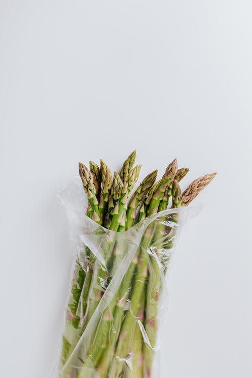 Bunch of raw asparagus in plastic bag