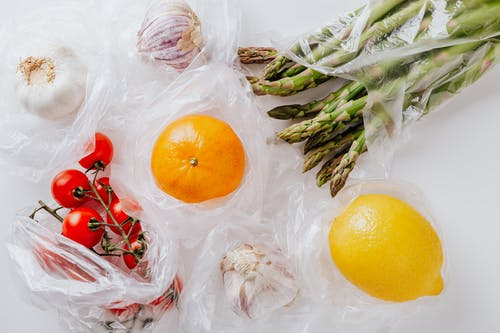 Fresh fruits and vegetables put in plastic bags