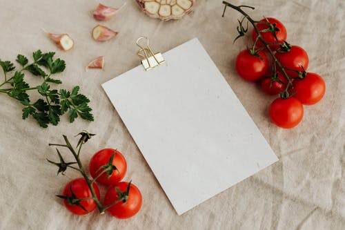 Set of tasty fresh vegetables and parsley with empty clipboard