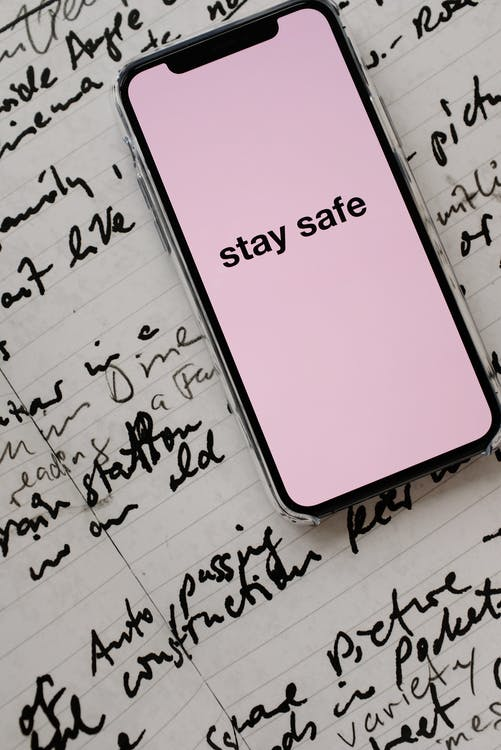 Smartphone With Stay Safe Note On Screen