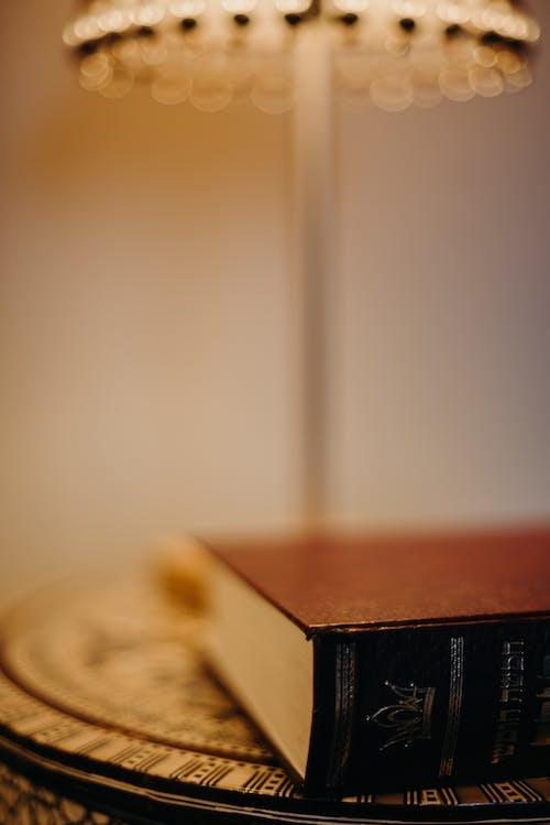 A Book Near A Table Lamp
