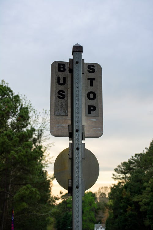 Gray and Black Bus Stop Sign