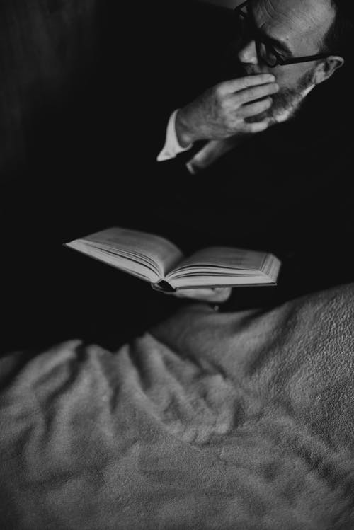 Bearded Man Holding a Book