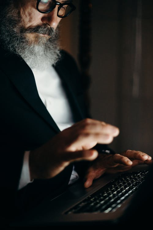 Photo Of An Old Man Using Laptop