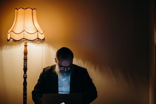 Photo Of Old Man Using Laptop