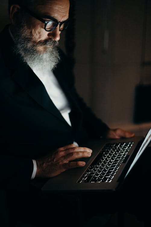 Photo Of An OId Man Using Laptop