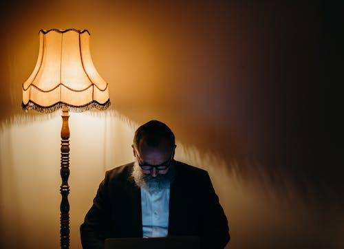 Photo Of Man Beside Lamp