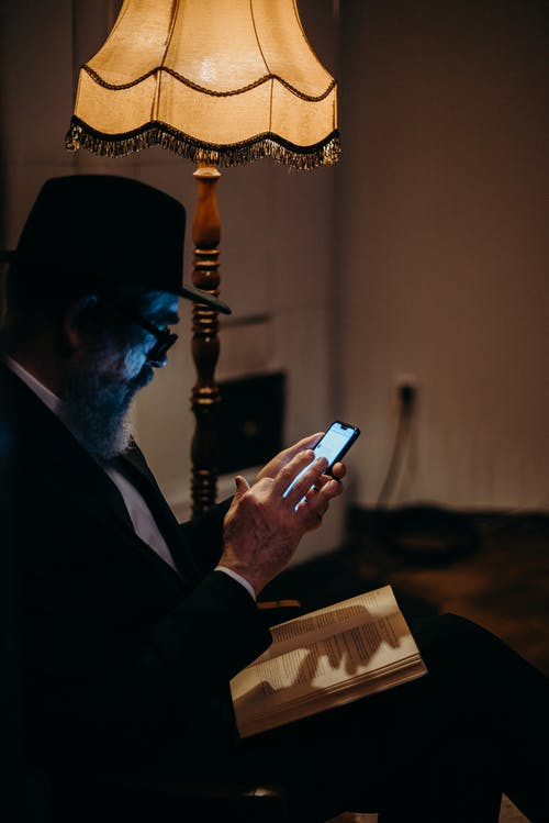 Photo Of Man Using Mobile Phone